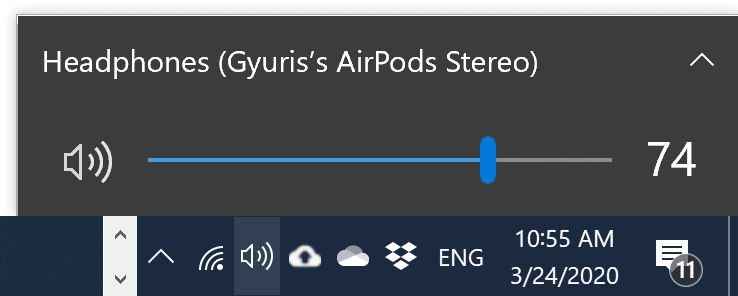Select AirPods as the output device by clicking on the Volume icon on the tray.